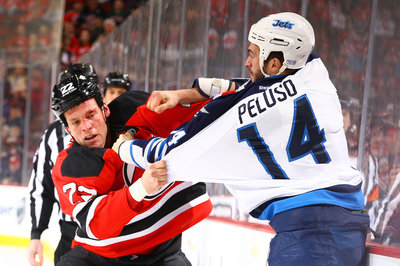 Jets' forward Anthony Peluso bloodies the 36-million-dollar man, David Clarkson.
