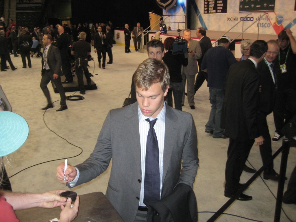 Taylor Hall was there as part of the entourage that selected Nugent-Hopkins 1st overall. Afterwards, he resigned himself to signing autographs half-heartedly for eager young fans